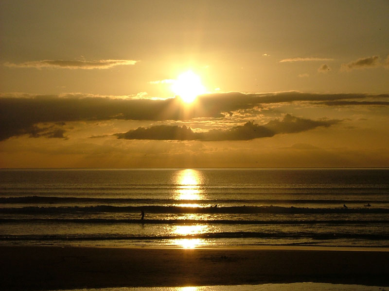 Surfers at sunset - Strandhill